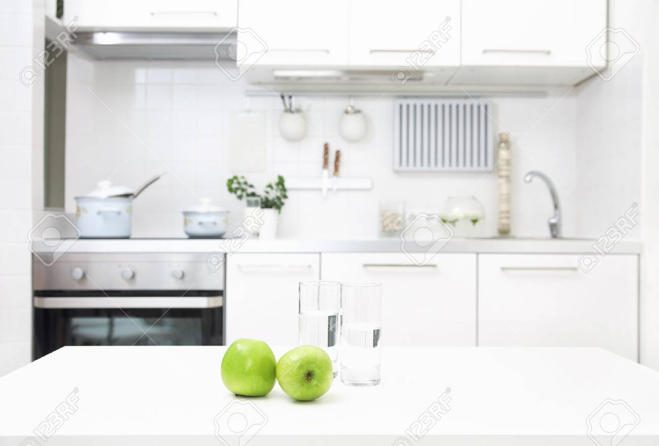 interior of small white kitchen with fresh apples on the table - 21504585