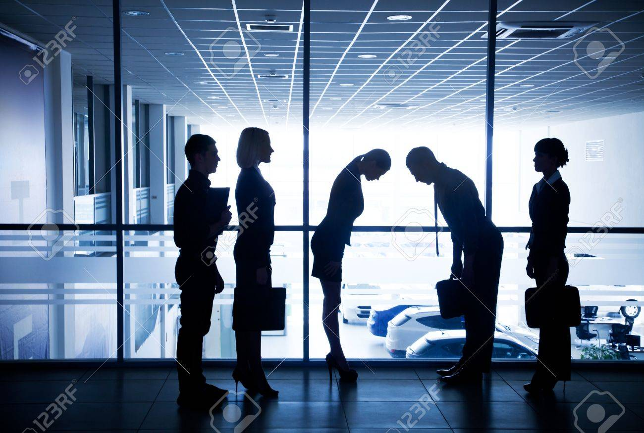 Several silhouettes of businesspeople interacting  background business centre Stock Photo - 21894597