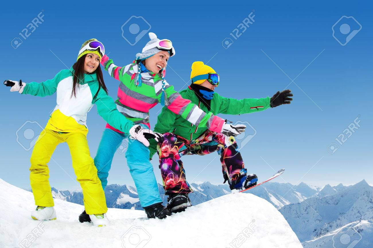 group of snowboarders slides from the mountaint along the road extreme Stock Photo - 26465035