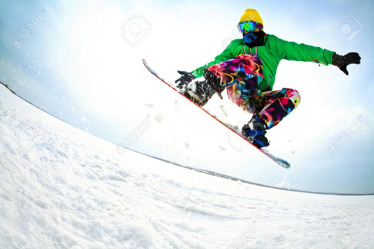 snowboarder jumping from the mountaint along the road extreme Stock Photo - 26465039