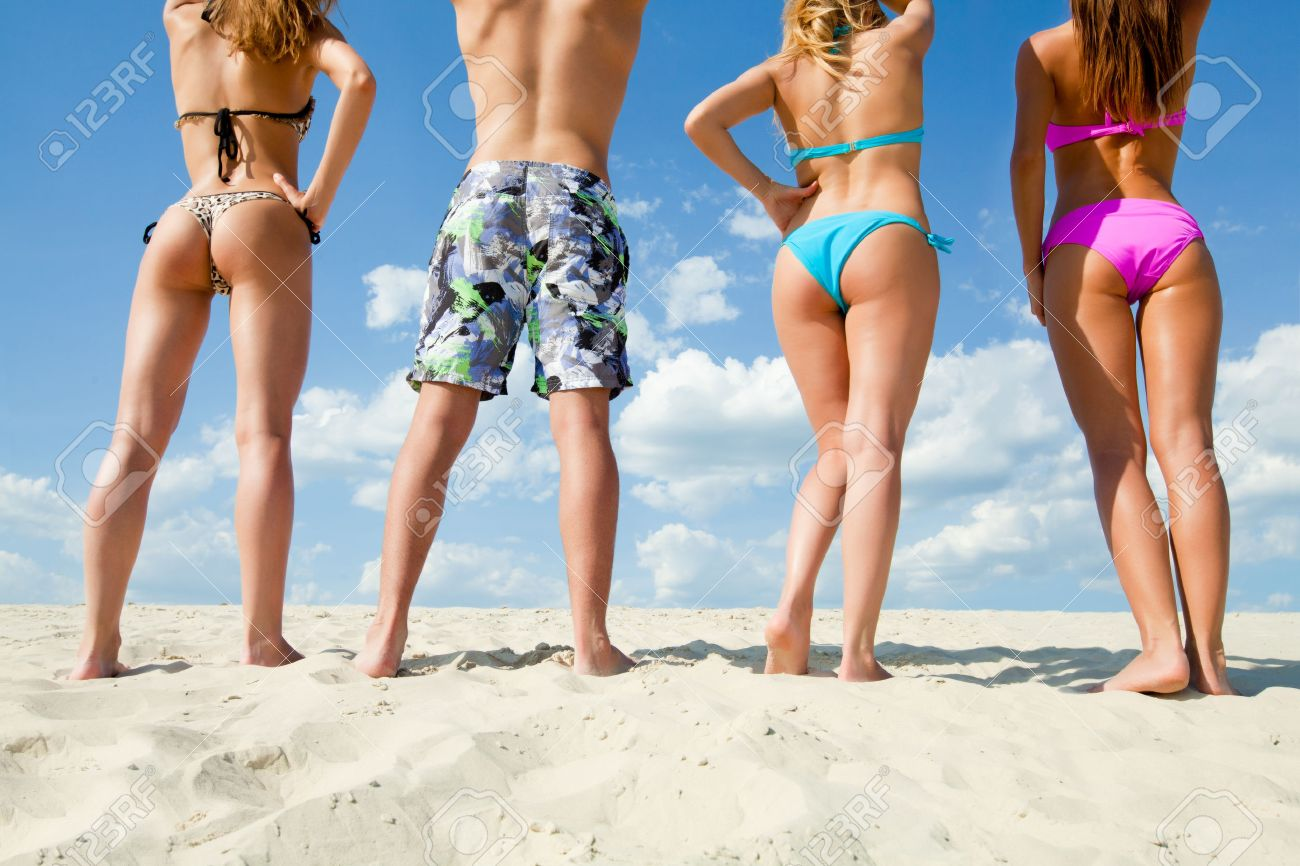 Young people are having good time on the beach  Back view  unrecognizable Stock Photo - 26659969