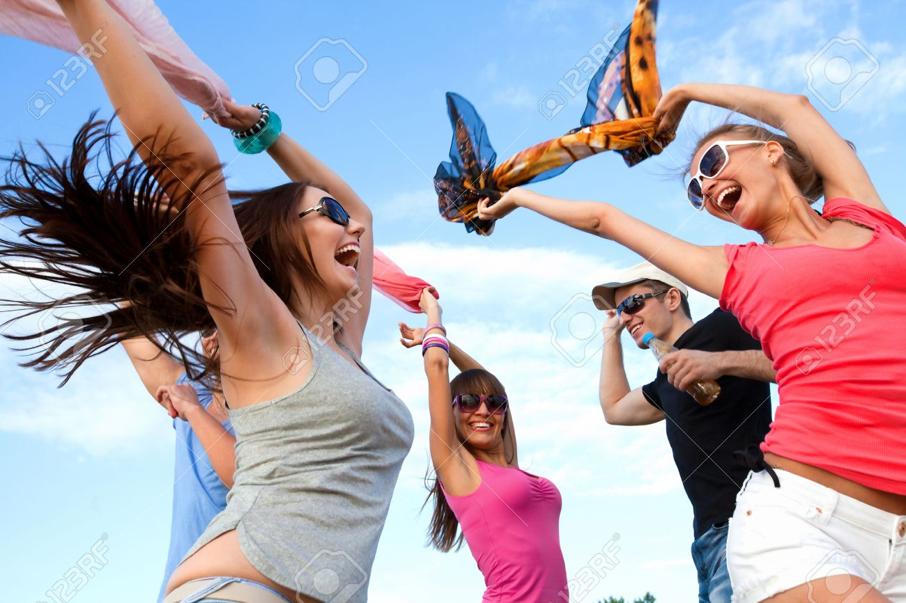 Large group of young people enjoying a beach party Stock Photo - 26659971