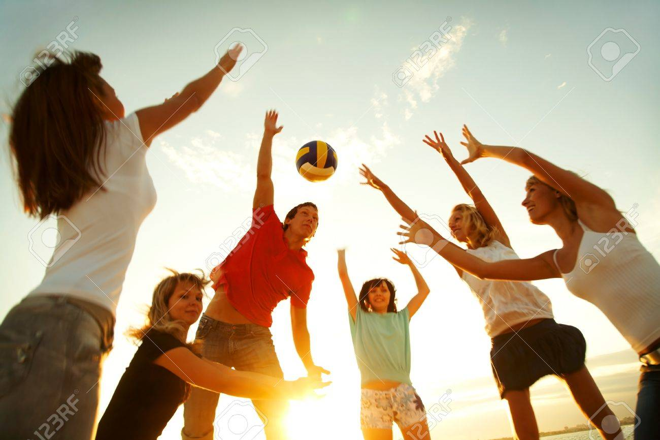 group of young people playing volleyball on the beach Stock Photo - 27439249