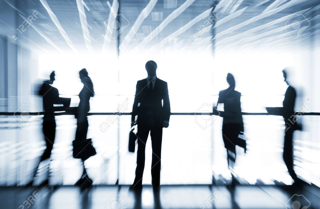 Several  silhouettes of businesspeople interacting  background business centre Stock Photo - 27439586