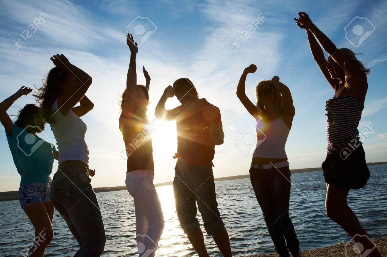 group of happy young people dancing at the beach on  beautiful summer sunset Stock Photo - 27439612
