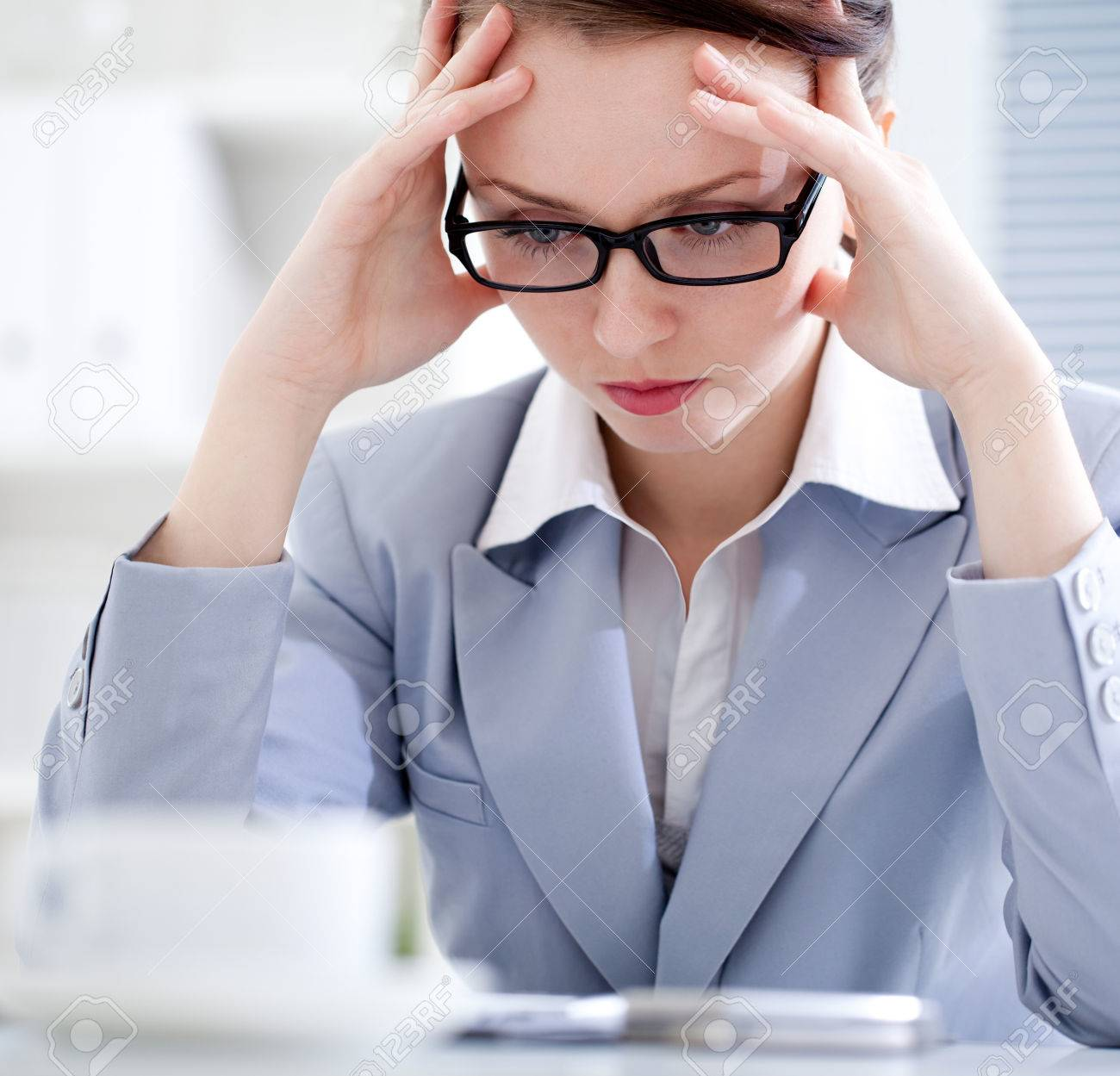 Portrait of exhausted businesswoman in office Stock Photo - 32268548