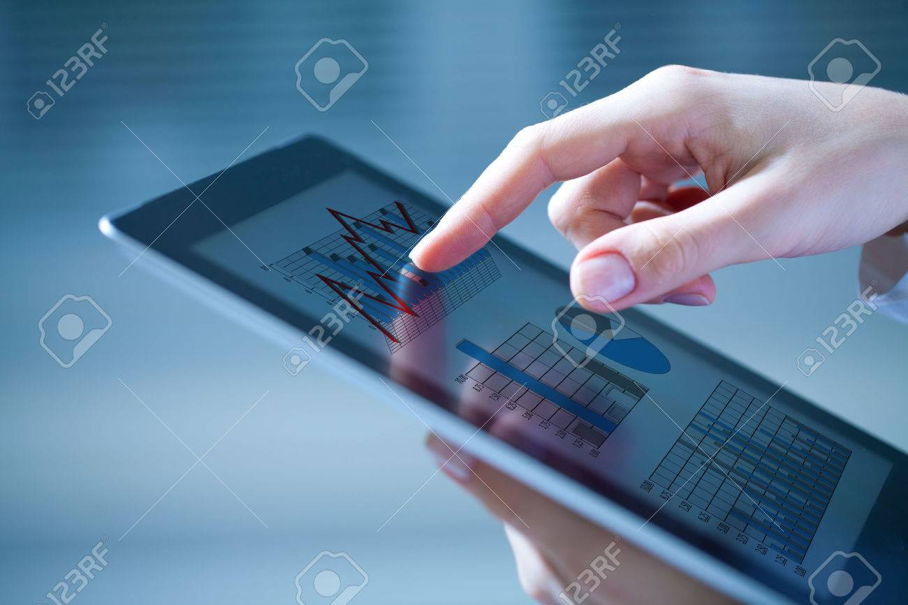 Close-up of female hands touching digital tablet with business diagram Stock Photo - 32268569