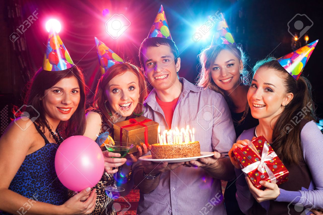 group of young people on birthday party - 52892516