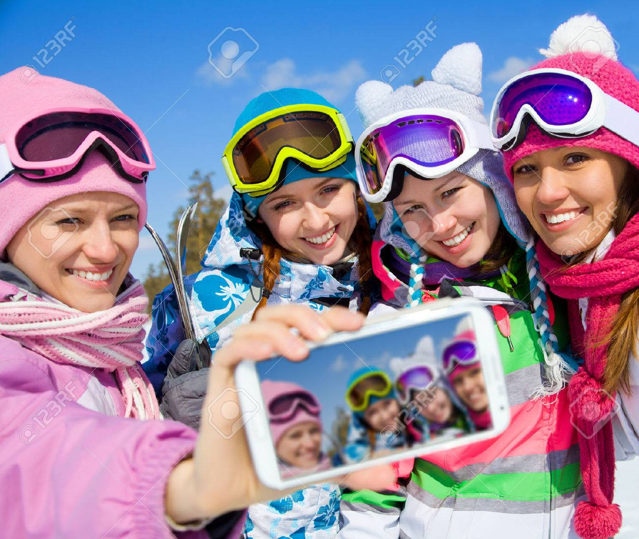 winter group of young woman  salfy in ski resort Stock Photo - 36626034