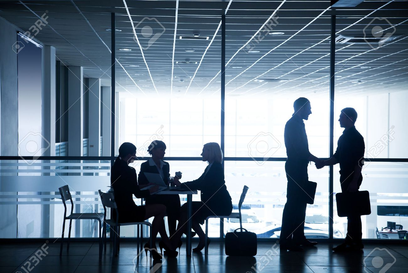 Several silhouettes of businesspeople interacting  background business centre Stock Photo - 36651745