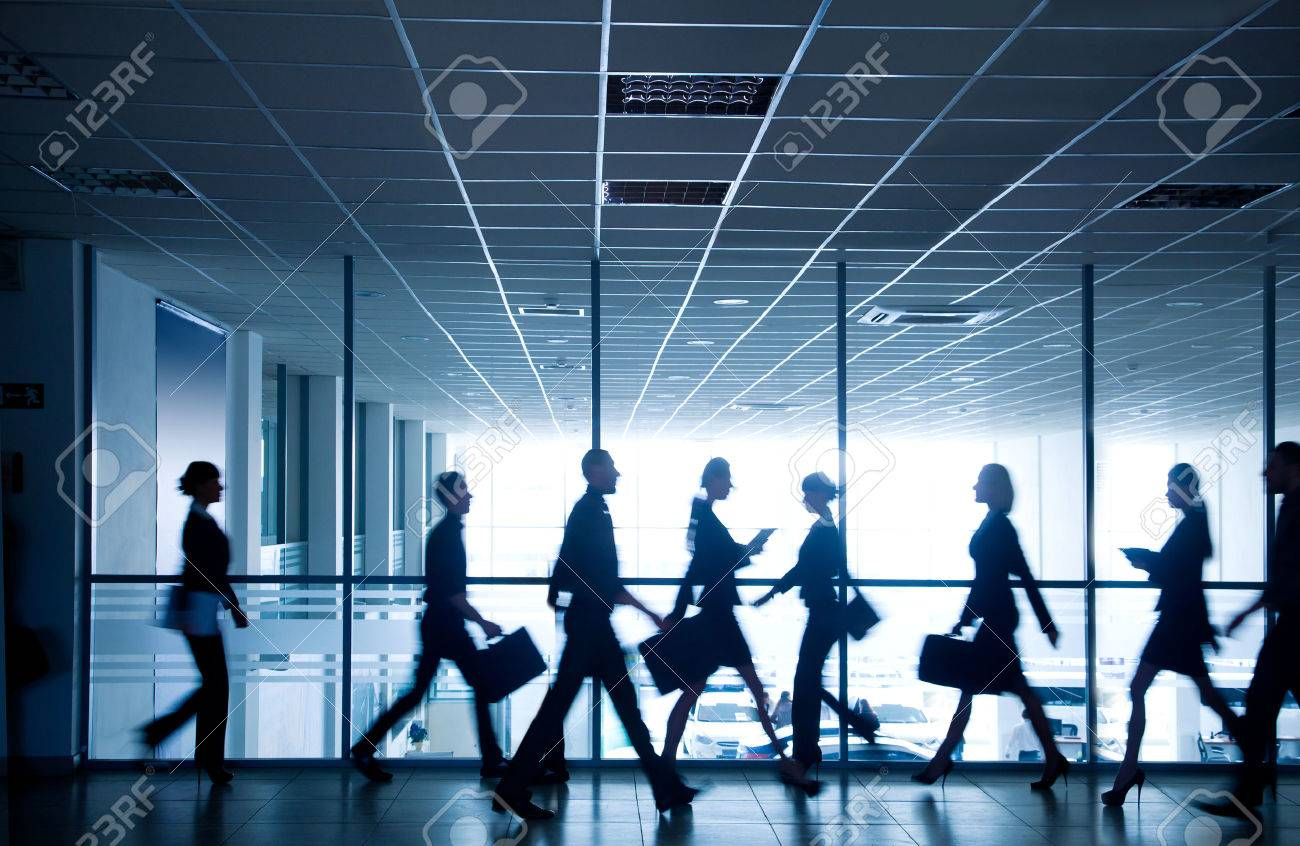 silhouettes of business people rushing for the large windows in the background Stock Photo - 36651754