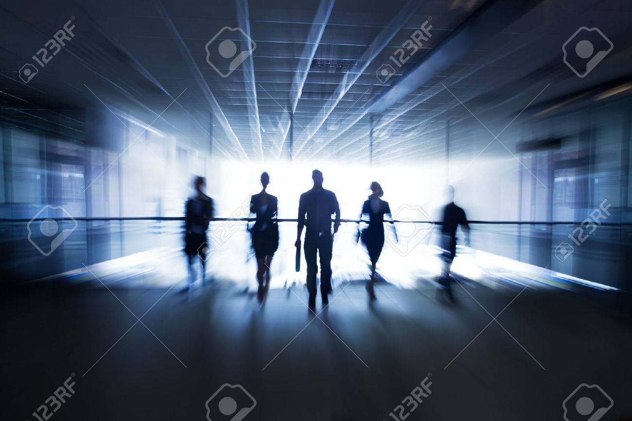 Several silhouettes of businesspeople interacting office background Stock Photo - 36651758