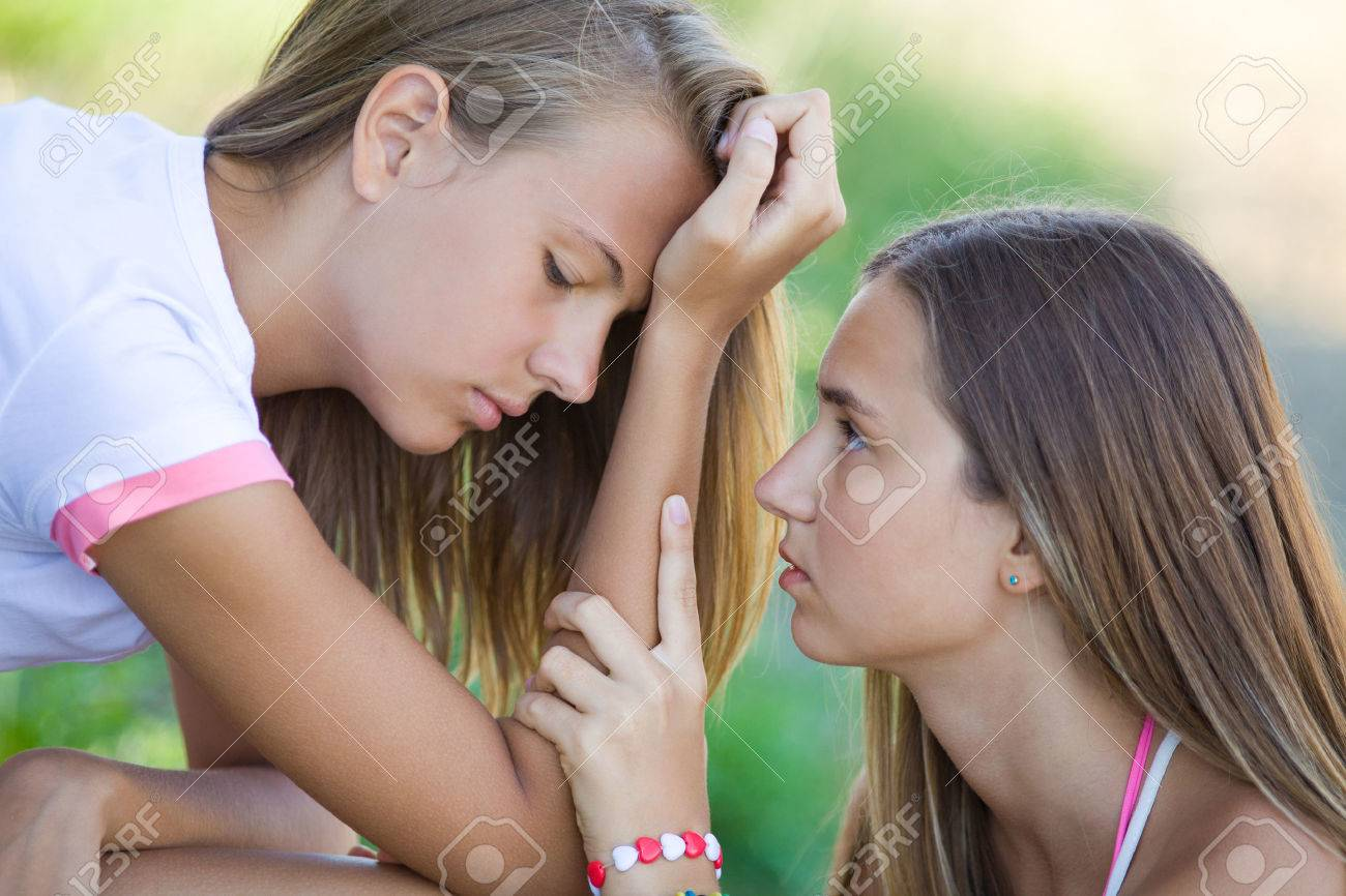 young girl comforting her friend in a depression Stock Photo - 42669391
