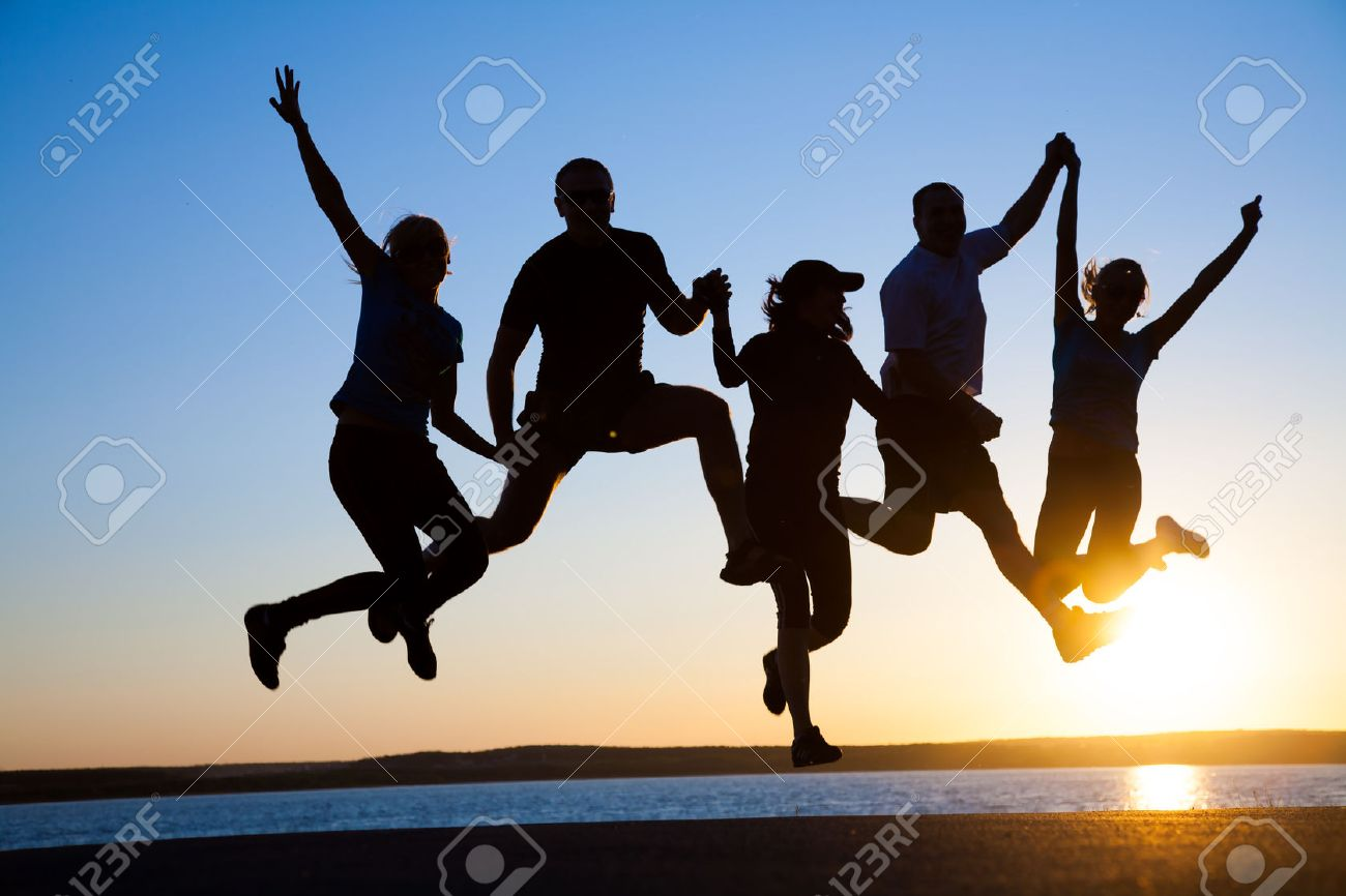 group of happy young people jumping at the beach on beautiful summer sunset - 54918810