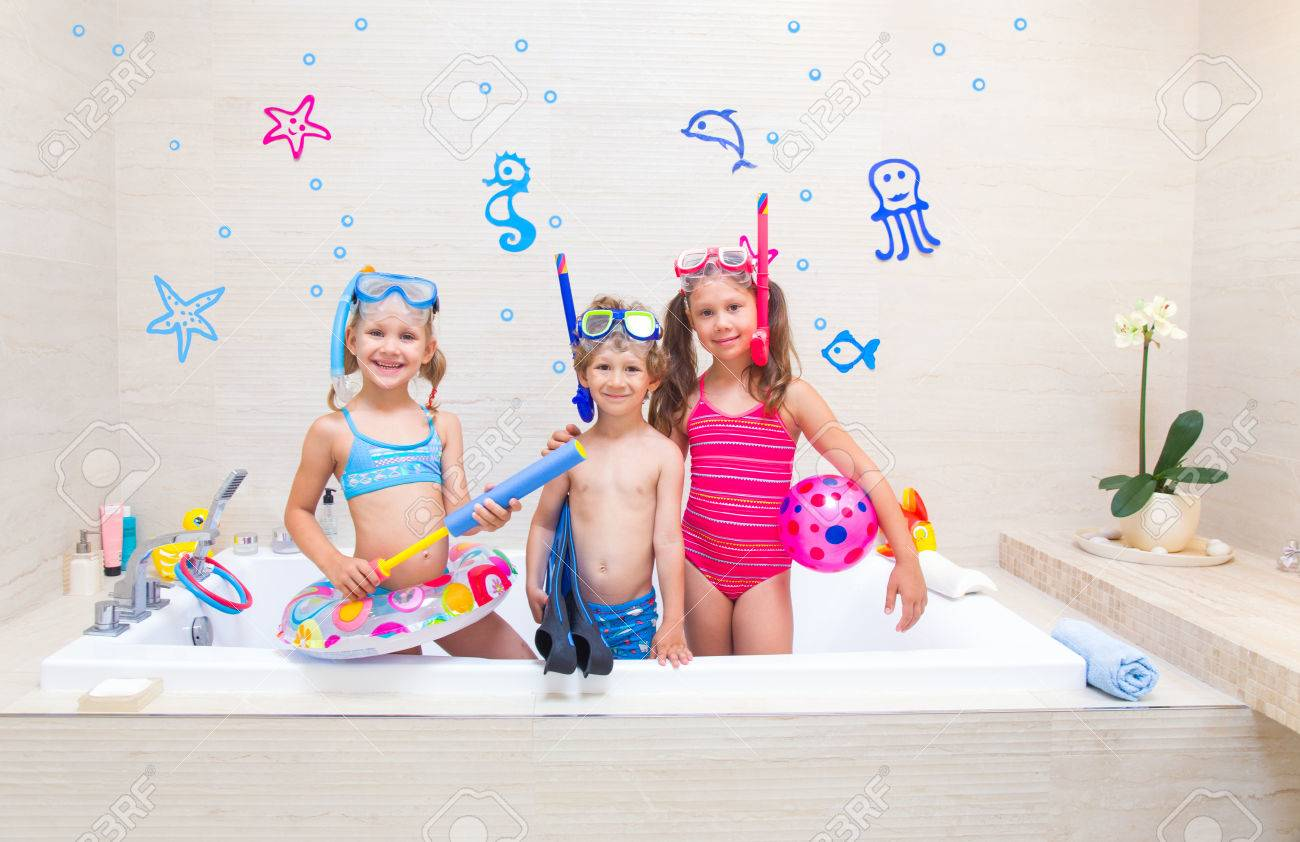 f6084766ab047 Little children in swimsuits play in the bathroom like in the sea Stock  Photo - 82818672