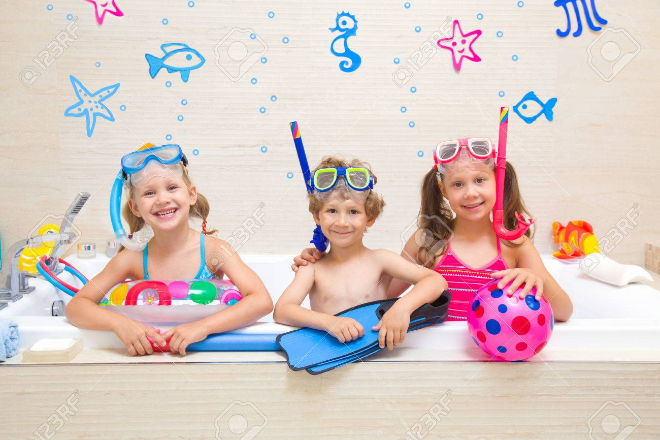 b649285c87138 Little children in swimsuits play in the bathroom like in the sea Stock  Photo - 82818677