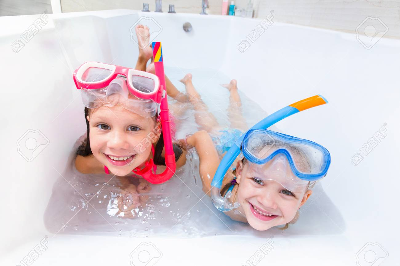 fc7b22829b803 Little children in swimsuits play in the bathroom like in the sea Stock  Photo - 82818678