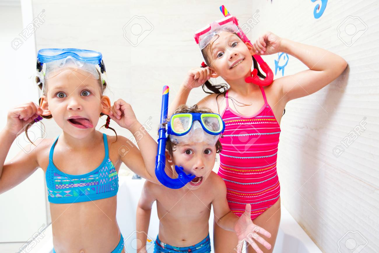 5f37c99a5f75a Little children in swimsuits play in the bathroom like in the sea Stock  Photo - 100400469