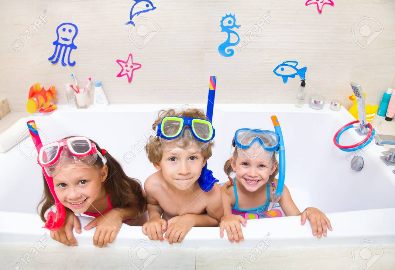 4a373f00a4ba5 Little children in swimsuits play in the bathroom like in the sea Stock  Photo - 100428888