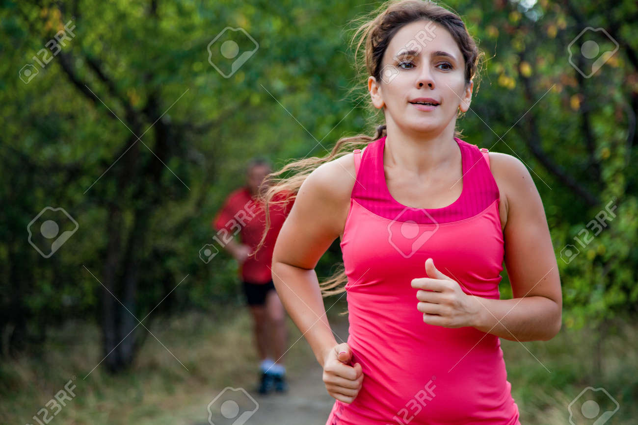 f woman in elderly age jogging on a summer day - 167488190