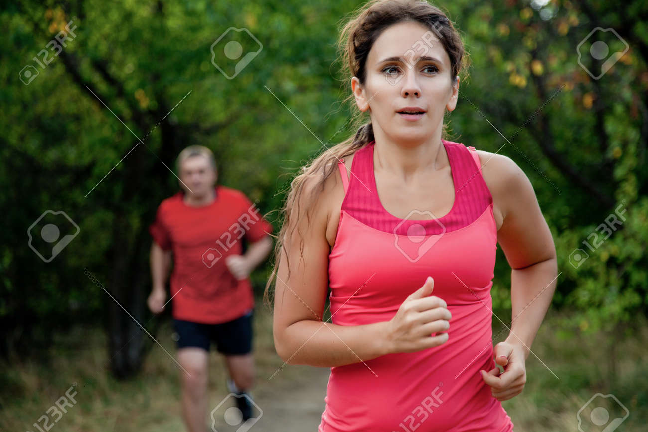 Pair of elderly people jogging on a summer day - 167488324