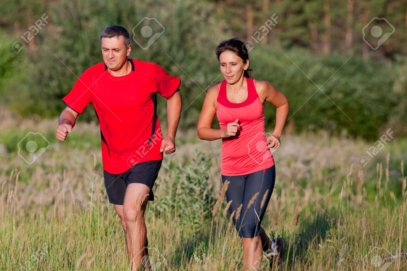 Pair of elderly people jogging on a summer day - 167488230