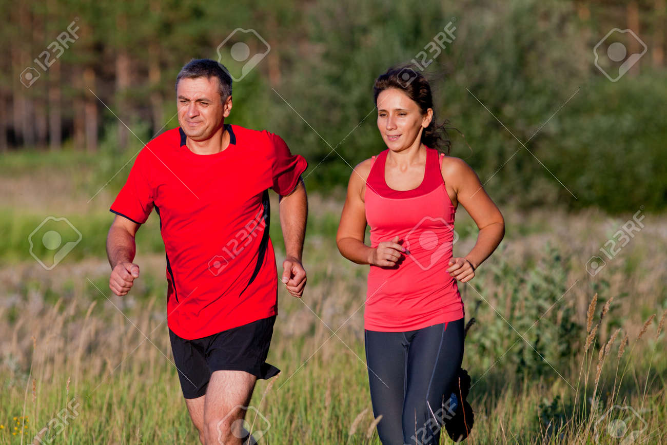 Pair of elderly people jogging on a summer day - 167908295