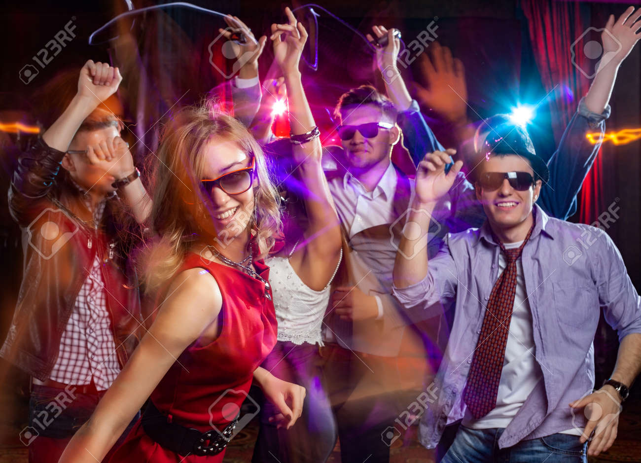 Group of young people dancing at the disco club - 168042595