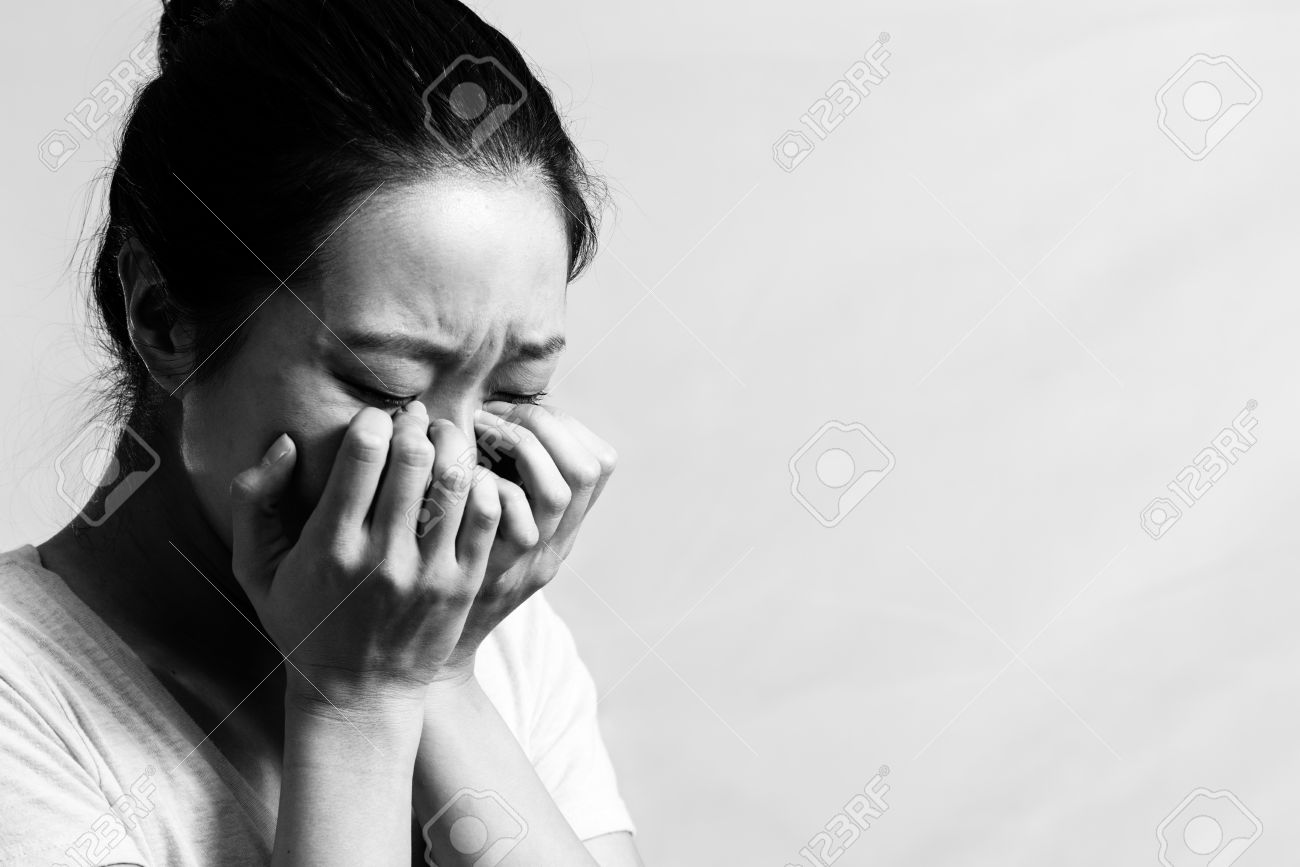 Portrait of pretty girl crying desperately black and white style stock photo 23921357