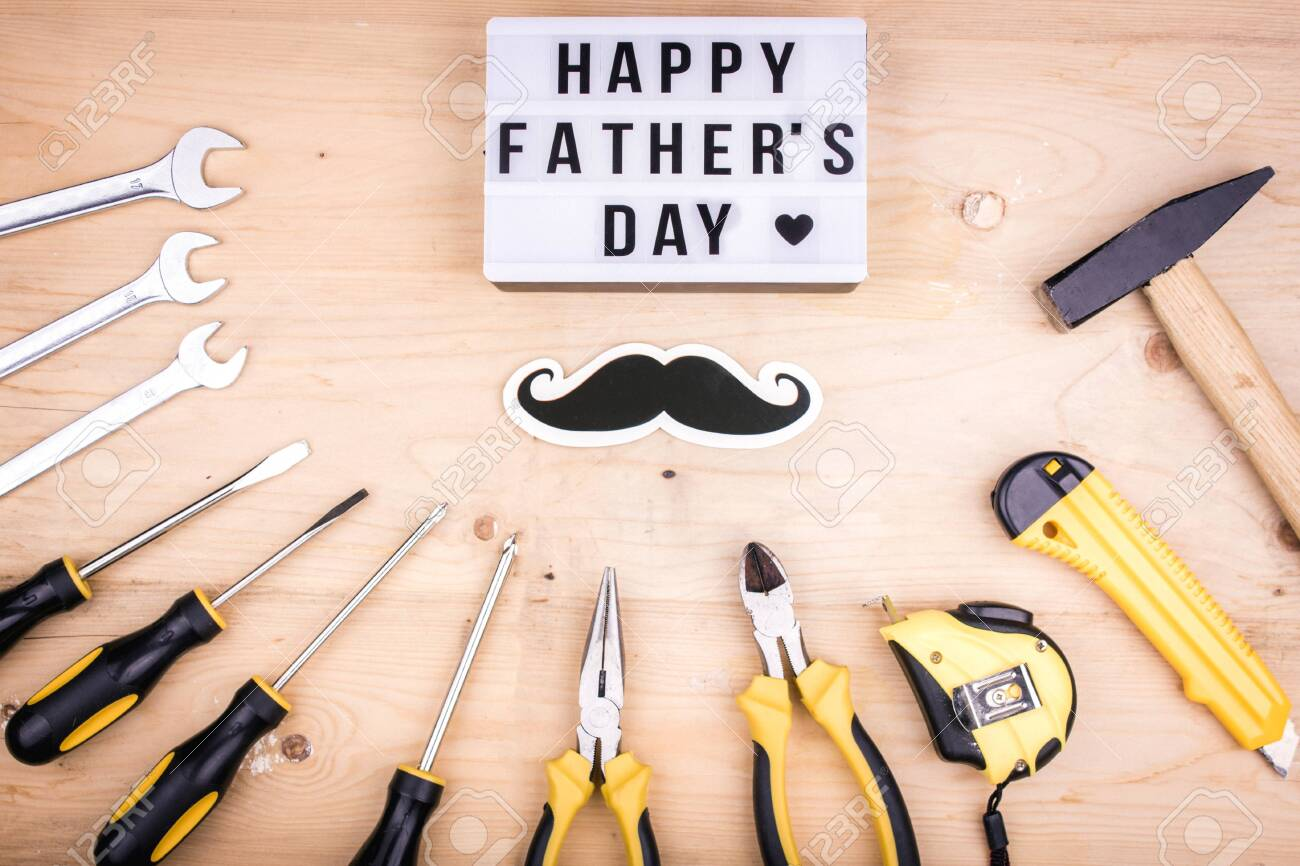 Repair tools - hammer, screwdrivers, adjustable wrenches, pliers. Male concept for a Father's day - 122938657