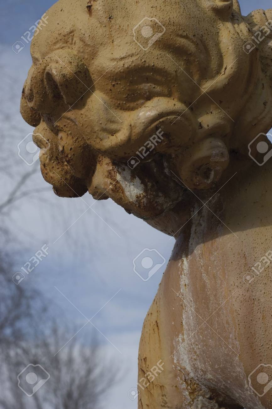 Rear view of a cherubin statue with blue sky background Stock Photo - 693935