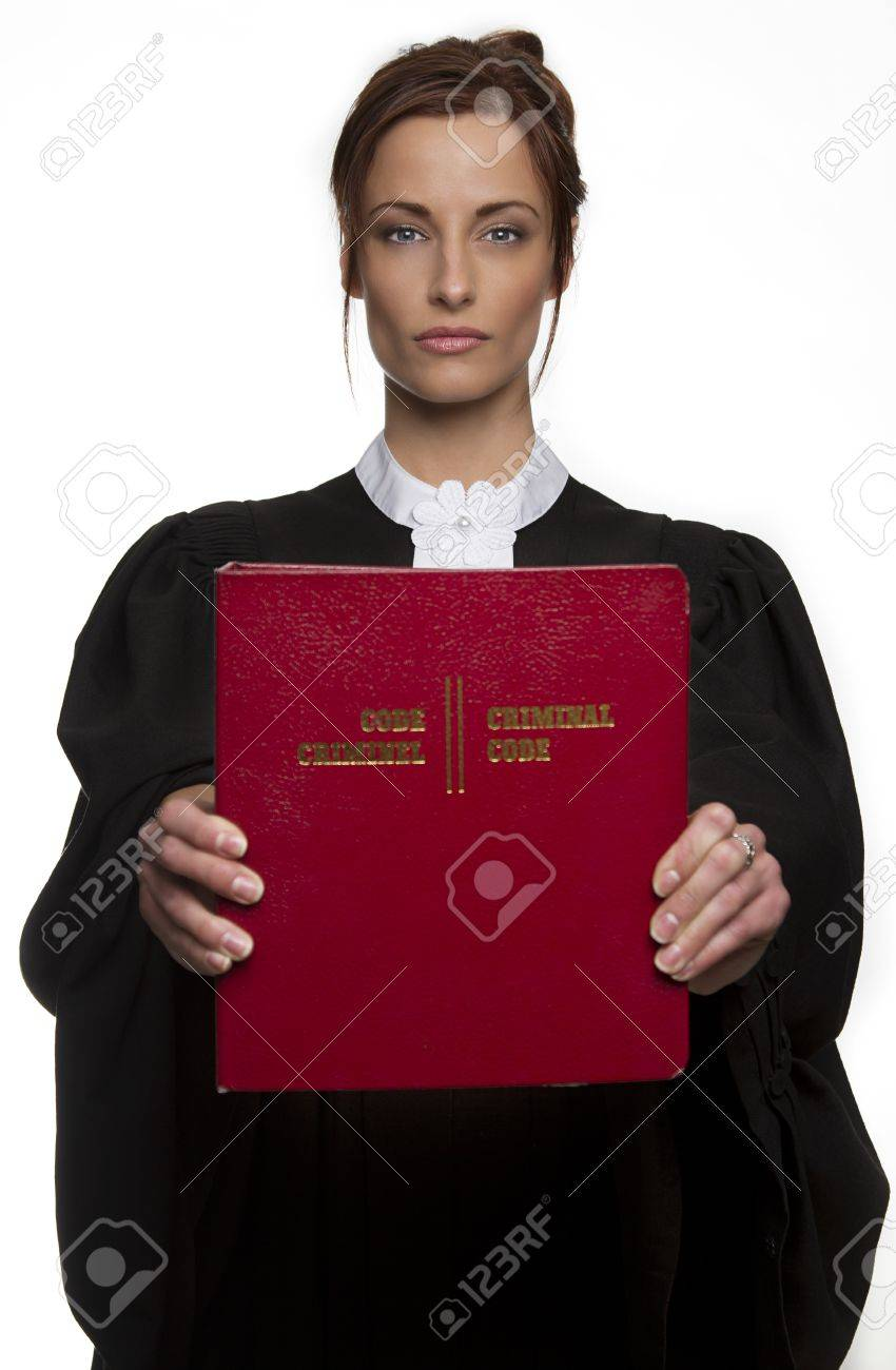 Women dress as a canadian attorney, holding a red book of criminal law, front and center, with bilingual text on it Stock Photo - 13020865