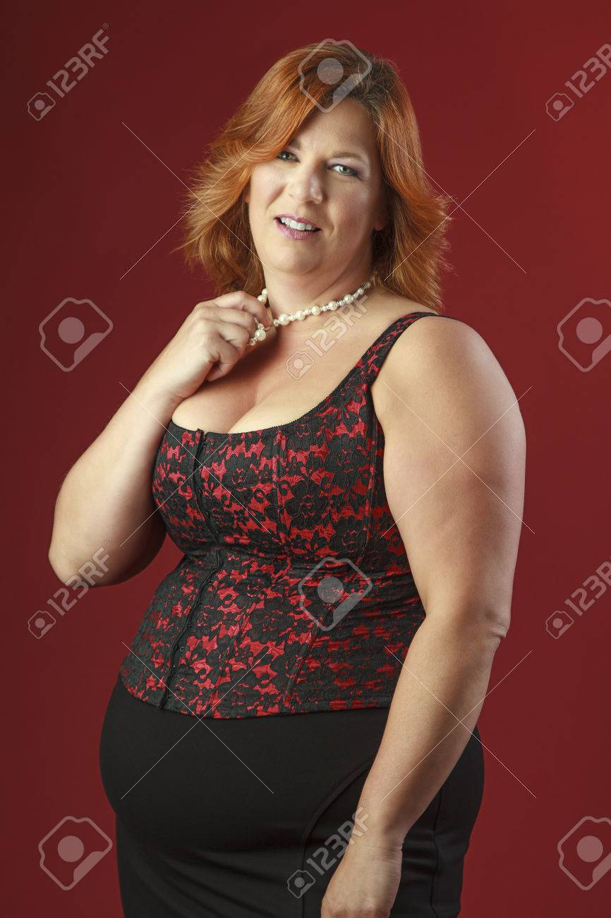 Stock Photo  Forty Year Old Woman Overweight Woman, Playing With Her Pearl  Necklace