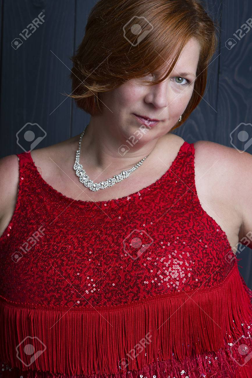 Sexy Forty Year Old Woman Wearing A Sparkly Dress Stock Photo 81857858