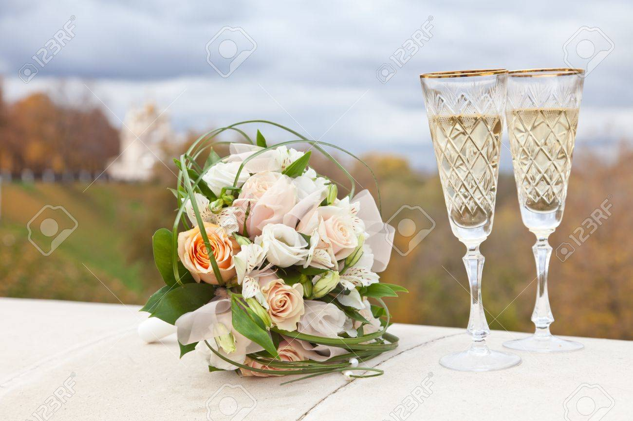 photo wedding bouquet and wine glasses with champagne wedding wine glasses Stock Photo Wedding bouquet and wine glasses with champagne