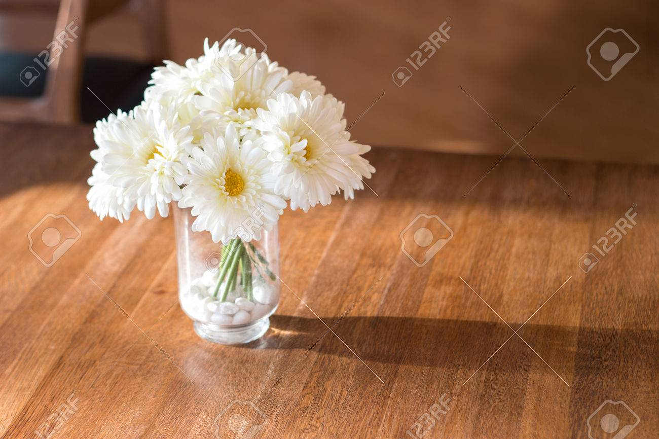Close up white artificial daisy flower in wase on wood table close up white artificial daisy flower in wase on wood table for background stock photo dhlflorist Gallery