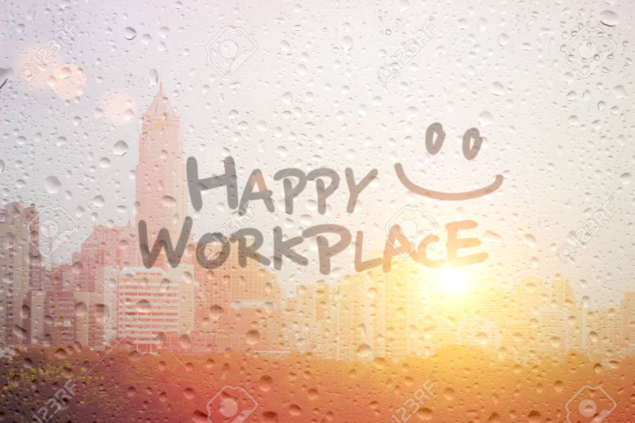 Draw smile symbol and happy workplace word in morning on window draw smile symbol and happy workplace word in morning on window and town landscape stock photo biocorpaavc Images