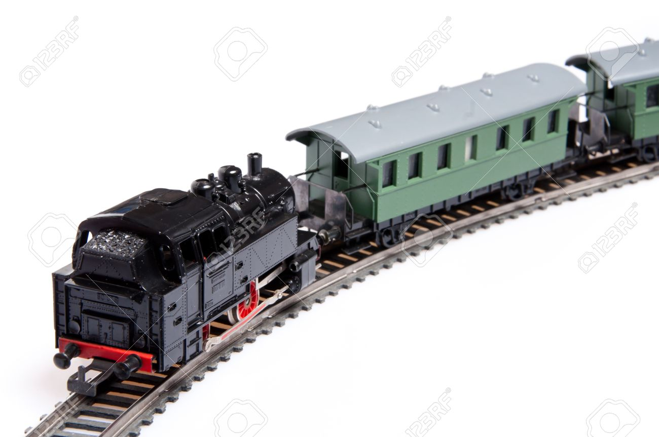 Toy steam train pushing two carriages isolated on white background Stock Photo - 11107463