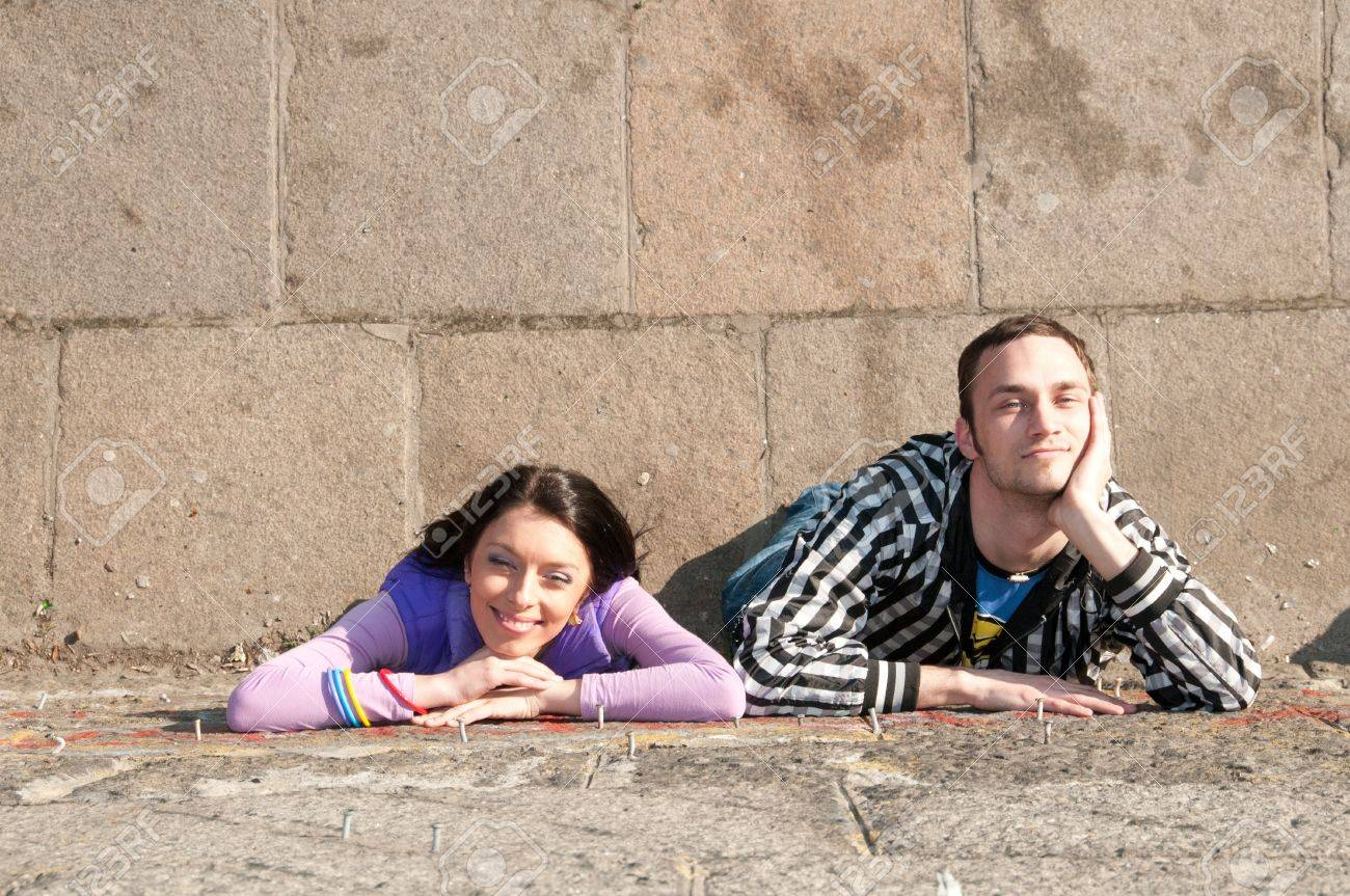 Sympathy  Boy and girl lie and smile Stock Photo - 14434532