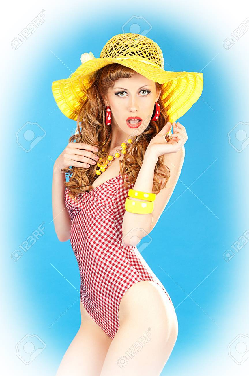 dbdd9b6bb15de Bright seductive charming pin-up girl in a pink bathing suit and a broad  yellow