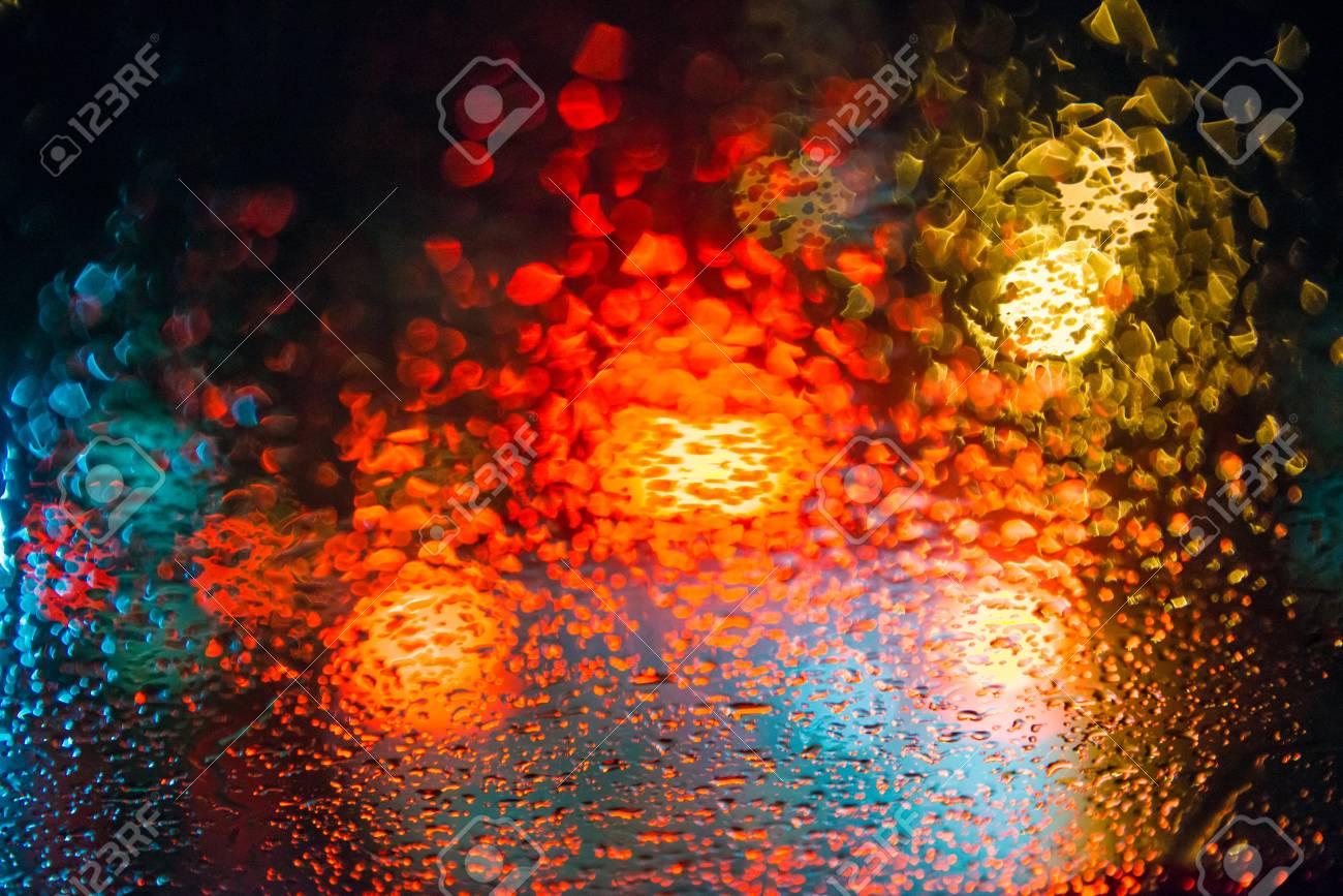 Rain Drops On Window With Street Bokeh Lights Colorful Street