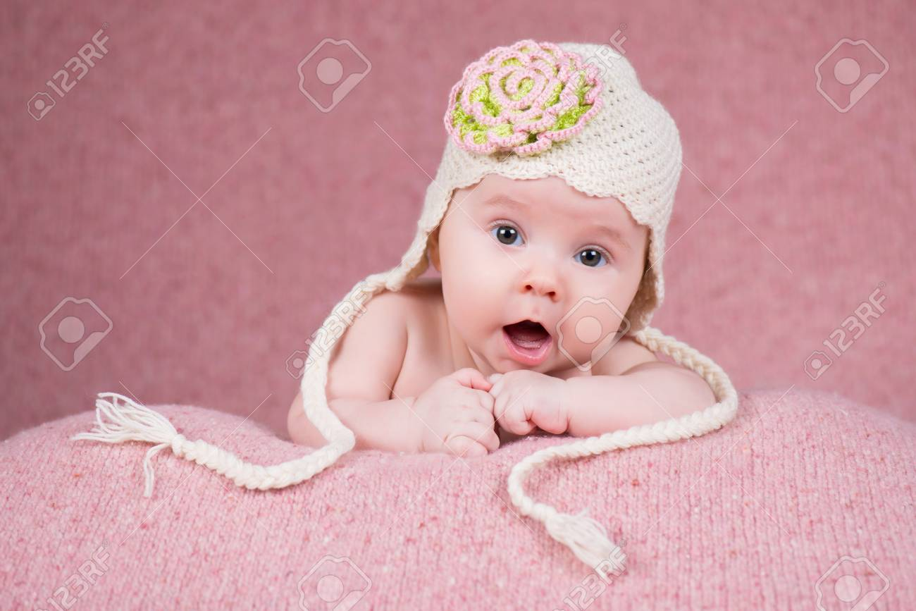 cab05b2cbad Newborn girl in warm knitted hat with a flower Stock Photo - 71000974