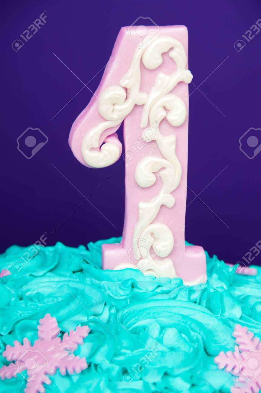 First Birthday Cake With A Unit On A Purple Background With Balls