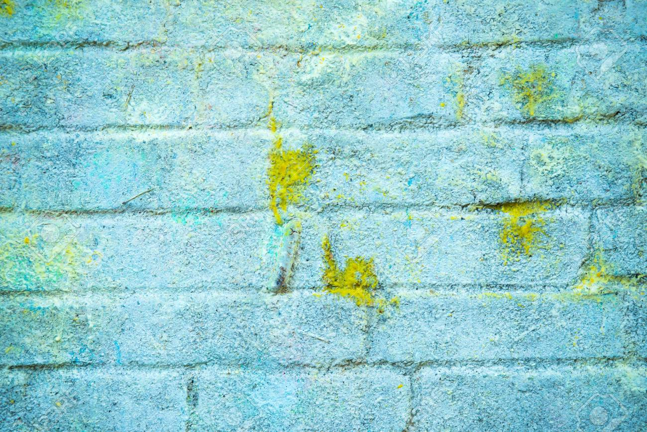Background And Wallpaper Or Texture Of A Blue Brick Wall With Stains Yellow Paint Stock