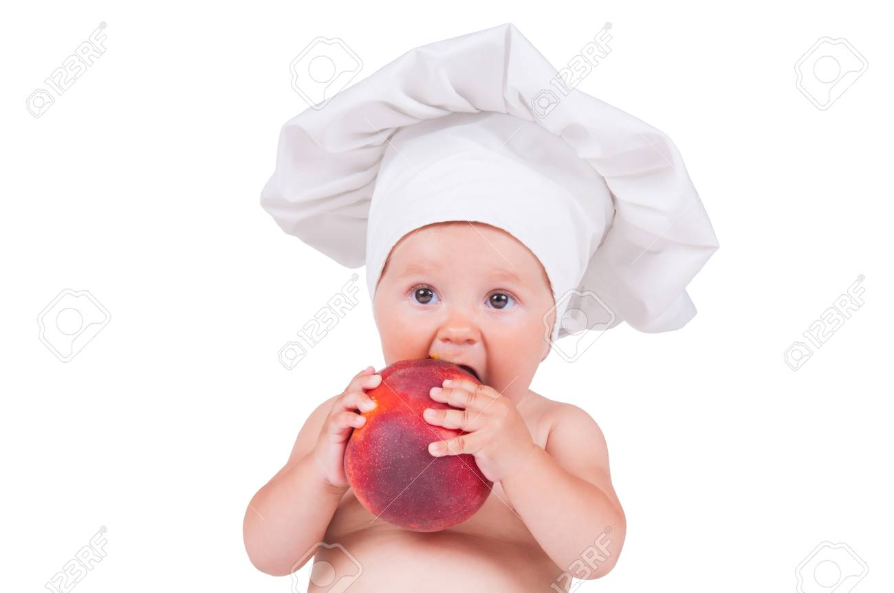d9e1b2f4b A small child is eating a big peach in a chef suit on a white background