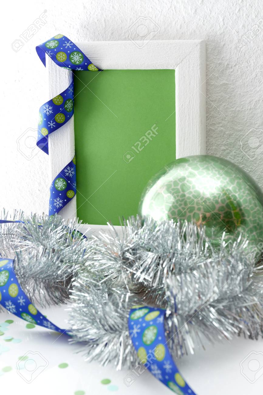 new year and christmas greeting card template made of white frame and green card with blue