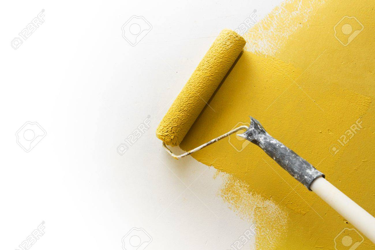 Paint Roller Applying Yellow Paint On White Wall, Home Improvements ...