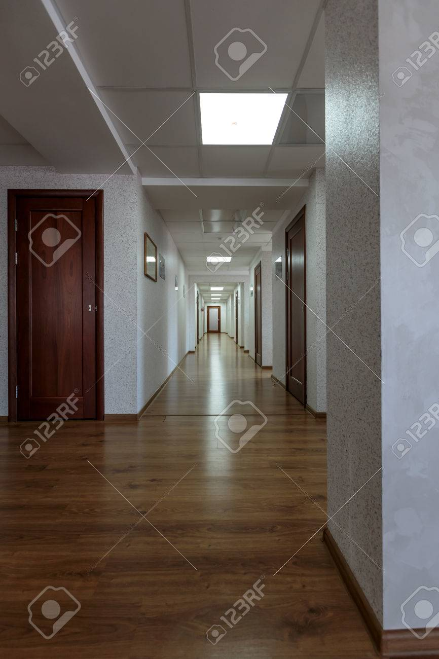 office hallway. Modern Generic Long Office Hallway With Wooden Floors And White Painted Walls Stock Photo - 56834525 )