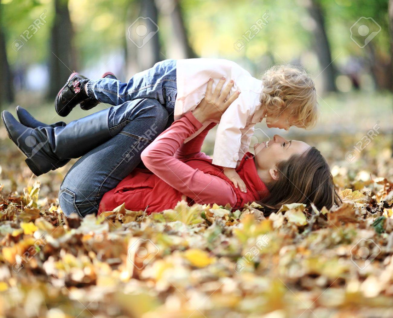 Happy family having fun in autumn park Stock Photo - 9767421