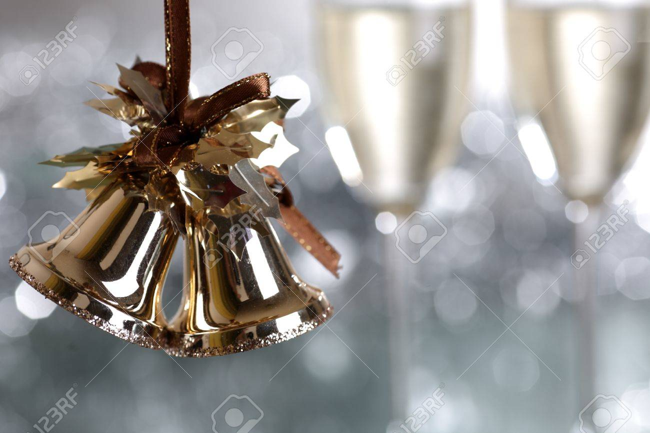Christmas bells against light blurred background Stock Photo - 9958187